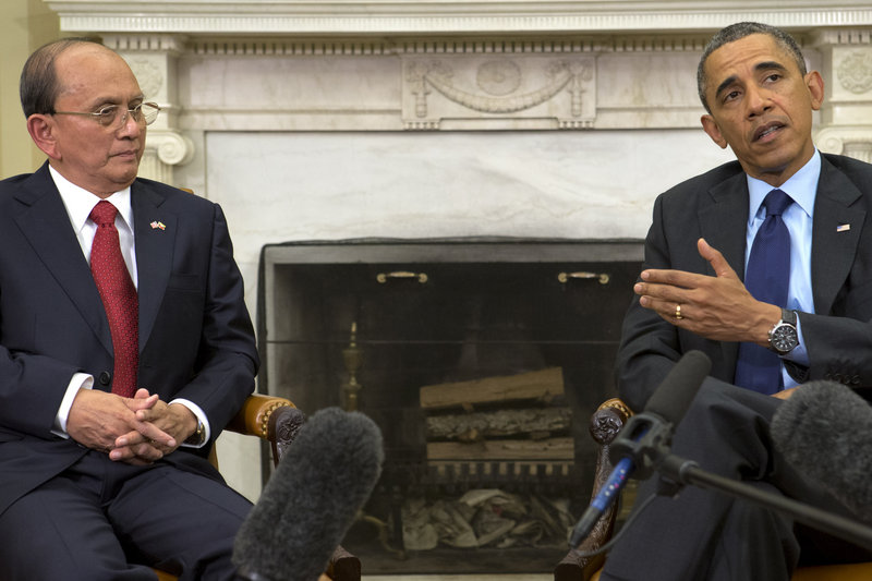 President Obama gestures toward Myanmar's President Thein Sein on Monday at the White House. Thein Sein previously served in a repressive junta, and his name was only deleted from a blacklist barring travel to the U.S. last September. Obama credited him for political and economic reforms and for ending significant tensions between their two nations.