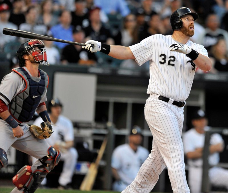 Adam Dunn of the White Sox and Red Sox catcher Jarrod Saltalamacchia watch Dunn's three-run homer sail over the right-field fence in the first inning Tuesday night, starting Chicago on its way to a 6-4 win.
