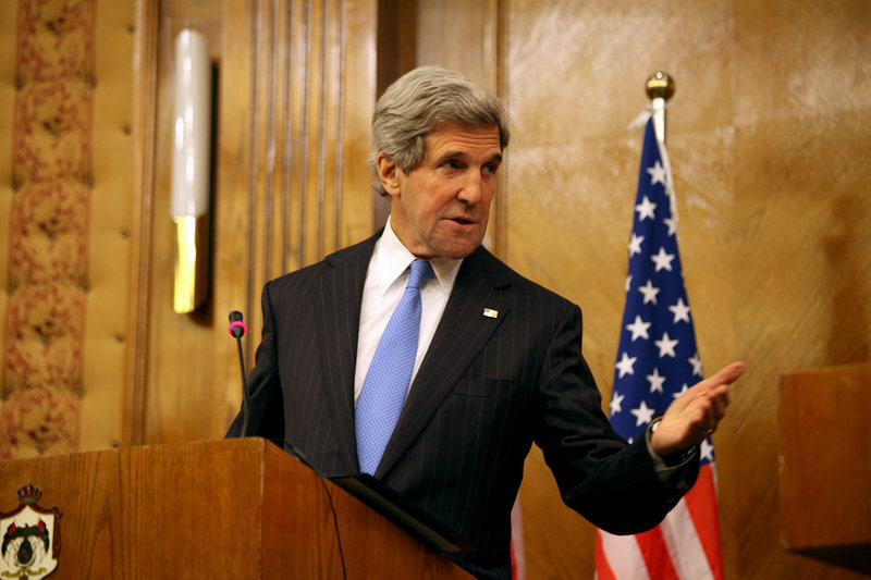 Secretary of State John Kerry speaks in Amman on Wednesday. Kerry said the United States and its allies will step up their support for Syria's opposition.