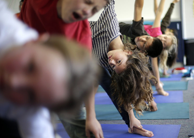 Students appear to take seriously their yoga class at Capri Elementary School in Encinitas, Calif. Experts would like schools to make physical education a core subject.