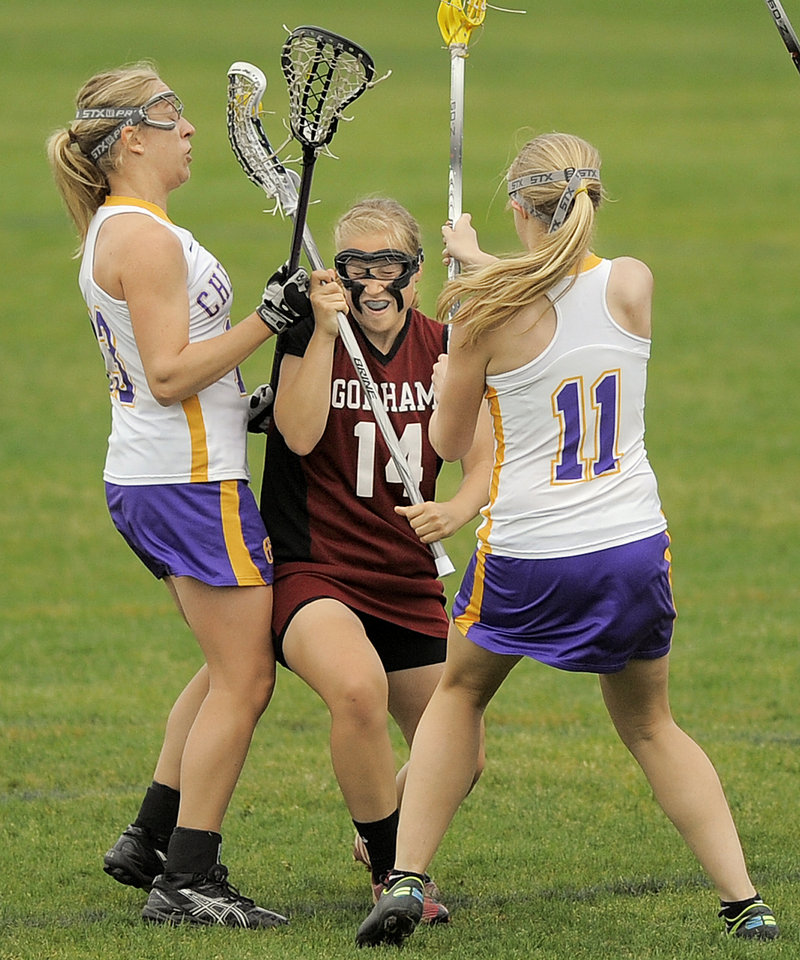 Meghan Cushing of Gorham looks to advance between Alex Logan, left, and Mary Kate Slattery of Cheverus during Cheverus' 14-12 victory Thursday in schoolgirl lacrosse.