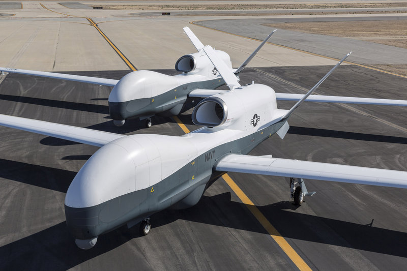 Two Northrop Grumman MQ-4C Triton drones are seen on the tarmac at a Northrop Grumman test facility in Palmdale, Calif., on Wednesday.
