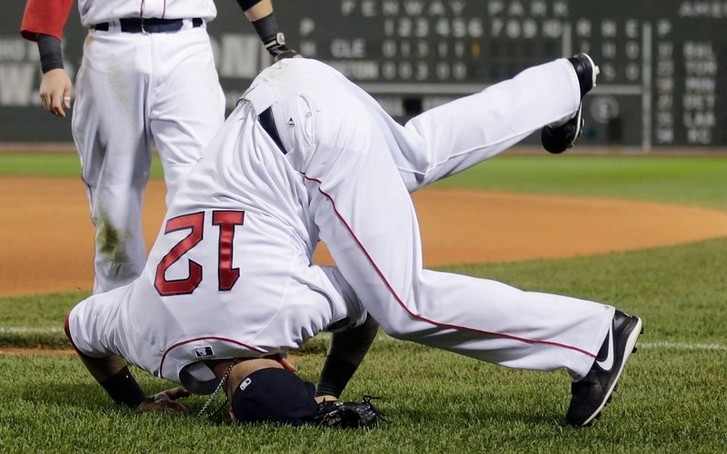 It was that kind of night for Boston as first baseman Mike Napoli lands on his head after missing a foul pop-up in the seventh inning of Thursday's lopsided loss to Cleveland.