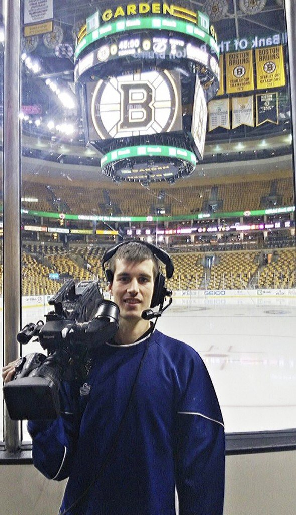 Maxx Coombs, with his camera, before a Bruins' game at TD Garden.