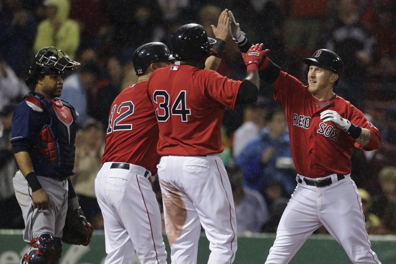 Boston's Mike Carp, right, is congratulated by Mike Napoli (12) and David Ortiz (34) after his three-run homer in the second inning off Cleveland starter Justin Masterson that helped spark the Red Sox to a convincing 8-1 victory at Fenway Park.