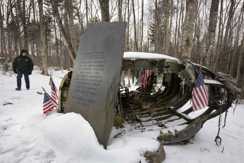 Greenville Police Chief Jeff Pomerleau views a monument near wreckage of a B-52 bomber on Elephant Mountain in this 2012 photo. The plane's vertical stabilizer snapped off, and the crash in January 1963 killed seven of the nine people on board. Air Force personnel from around the country gathered in Greenville on Saturday to remember the deadly crash.