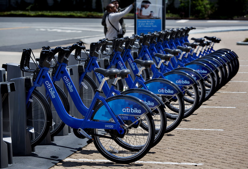 Bicycles are lined up at a dock and lock station at the Brooklyn Navy Yard as part of the bike share program.