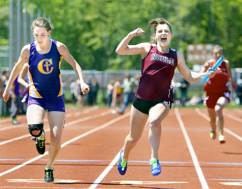 Dakotah Clement of Noble celebrates after edging Sarah Mount of Cheverus to give her team the victory Monday in the 400-meter relay at the SMAA track and field championships in Saco. Noble's time was 51.18 seconds, while Cheverus finished in 51.33.