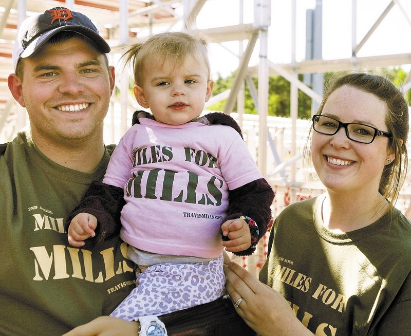 Staff Sgt. Travis Mills with daughter Chloe and wife Kelsey Buck Mills at Cony High School in Augusta.