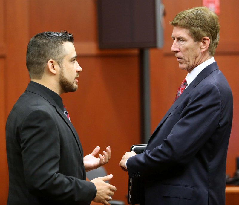 Robert Zimmerman Jr., left, the brother of George Zimmerman, the accused shooter of Trayvon Martin, talks with defense lawyer Mark O'Mara in a Florida court Tuesday.