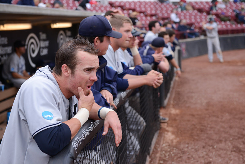 USM senior Tucker White and his teammates watch the final outs of the ninth inning.