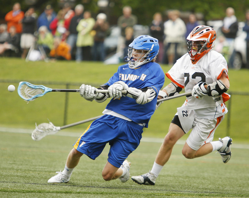 IV Stucker of Falmouth scores a fourth-quarter goal after slipping past Adrian McLaughlin of North Yarmouth Academy.