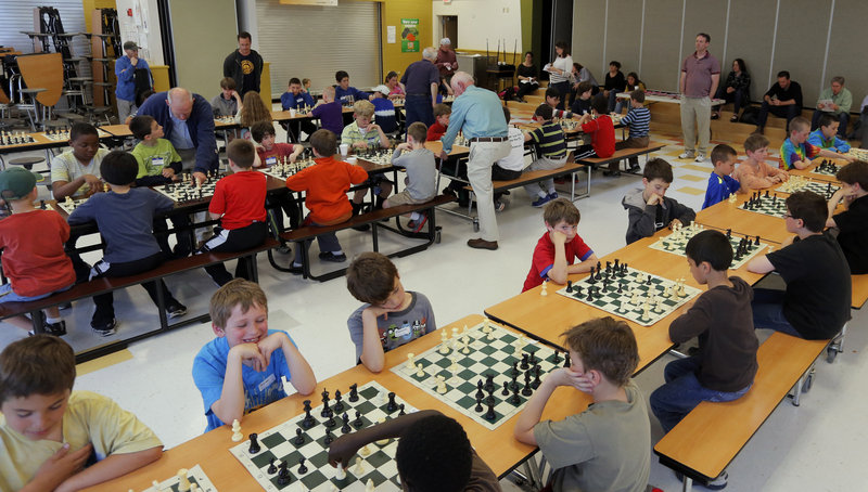 Students from East End Community School, Falmouth Elementary School and Ocean Avenue Elementary School, packed into the East End School cafeteria Wednesday, May 29, 2013, for the school's inaugural chess tournament.