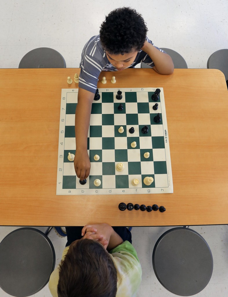 Gianni Aviles, top, a third-grader at East End Community School in Portland, makes his move during a chess match vs. Owen Davis, a Falmouth third-grader, Wednesday, May 29, 2013, at East End School's inaugural chess match.