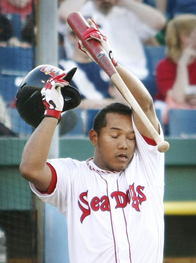 Portland's Heiker Meneses pauses to wipe sweat from his brow while at bat on a hot Friday evening at Hadlock Field.