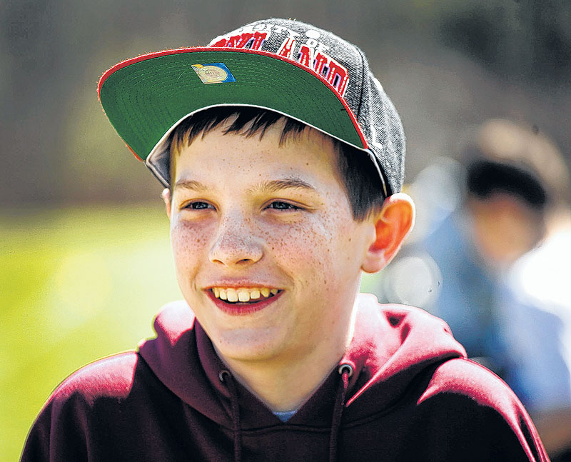 Matthew Freitas, 12, is all smiles as he watches his lacrosse team on the field. He would like to let others know that having an amputation need not destroy your dreams.