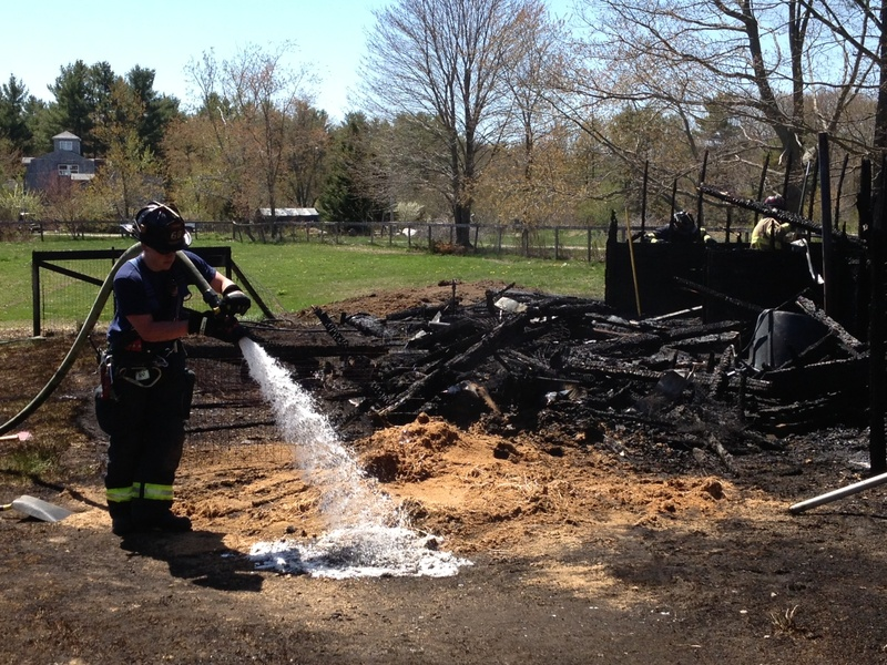 Saco firefighters work at the scene of a fire that destroyed a barn Tuesday.