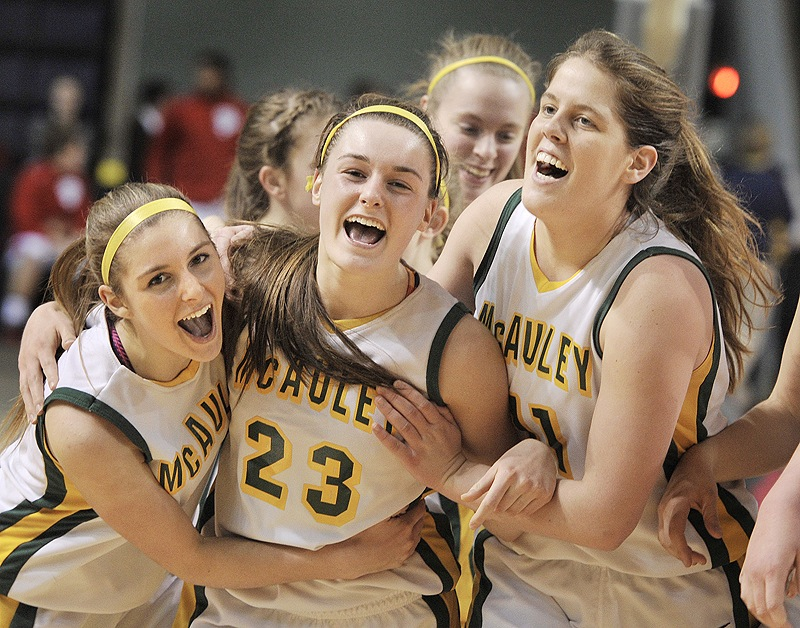Allie Clement, center, flanked by Sarah Clement, left, and Molly Mack, celebrates McAuley's third straight Western Class A title after beating Cheverus on Feb. 24, 2013.