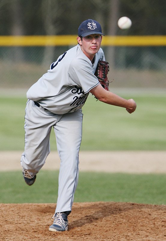 Andrew Richards pitches in relief Saturday during the game against Endicott College in the NCAA Division III New England baseball tournament in Harwich, Mass.