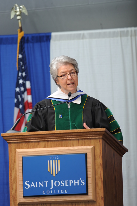 Anna Eleanor Roosevelt, president and CEO of Goodwill Industries of Northern New England, addresses the Class of 2013 at Saint Joseph's College's 100th commencement Saturday.    Photo credit: Fred Field