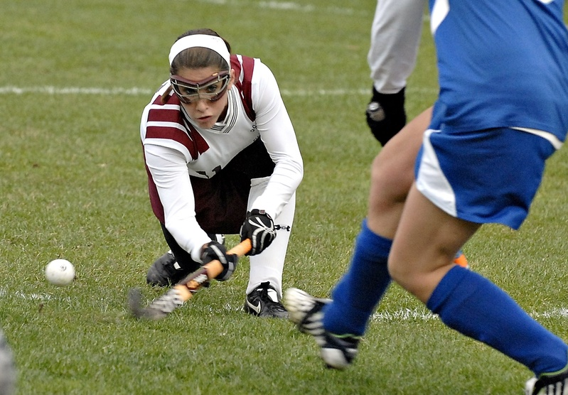 Hannah Prince of Gorham sweeps in with a low shot in this 2010 photo. Field Hockey