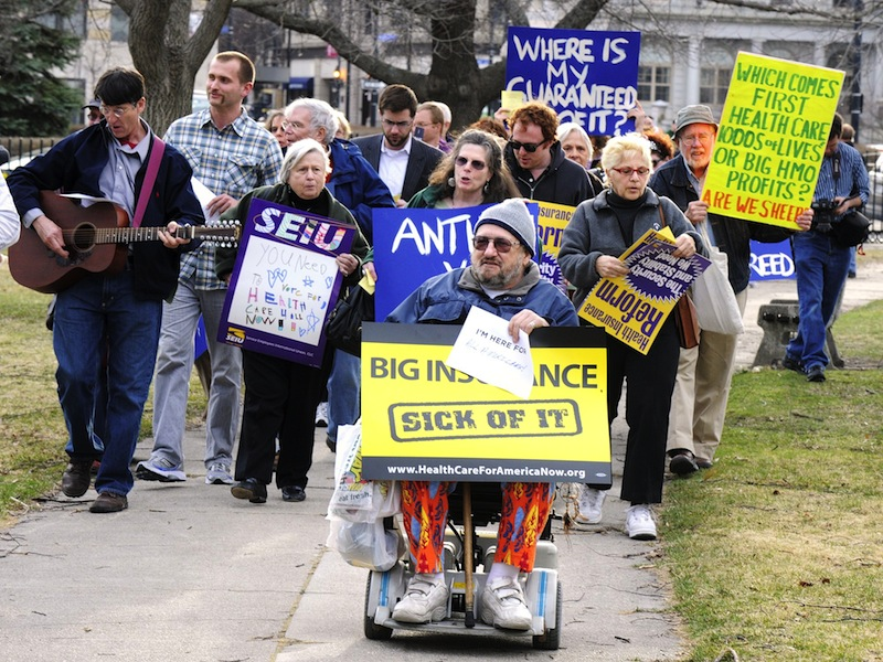 In this January 2011 file photo, demonstrators rally in Portland's Lincoln Park against efforts to overturn a state decision limiting health insurance rates. A pair of Democratic-backed adjustments to the Maine Republicans' 2011 health care reform law received initial approval in both houses of the Legislature, but will likely be vetoed by Gov. LePage.