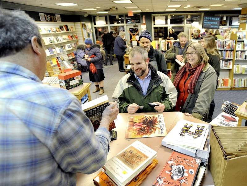 Josh Tiffany and his wife Heather Brigham Tiffany buy several books as patrons crowd the Longfellow Bookstore in Portland on Feb.14, 2013. The Maine Senate killed a bill Thursday, June 20, 2013 that would have allowed towns and cities to levy a sales tax on goods if they so preferred.