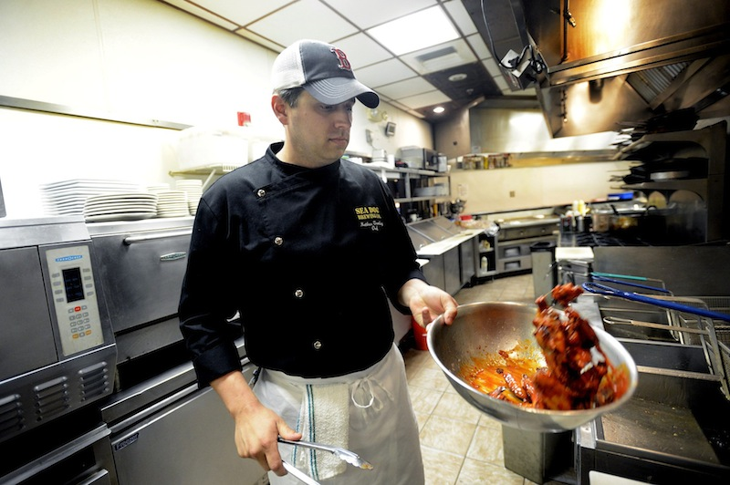 Chef Matthew Tremblay makes his BBQ wings at Sea Dogs Brewing Co. in South Portland Thursday, June 6, 2012. Tremblay will compete in the 2nd Annual Maine Hot Wing Cook-Off Challenge on Saturday, June 22.