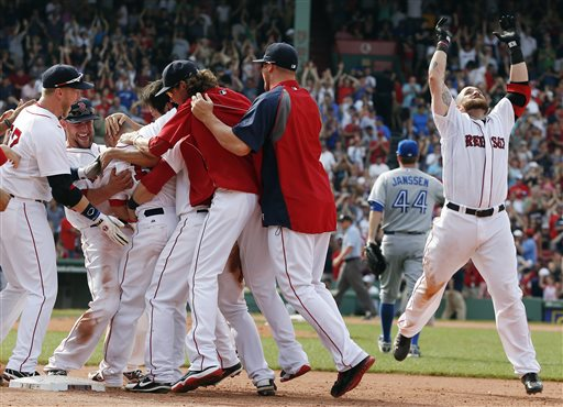 Boston's Shane Victorino, partially hidden third from left, celebrates with teammates after a fielding error by Toronto' Josh Thole in Boston on Sunday. The Red Sox won 5-4.