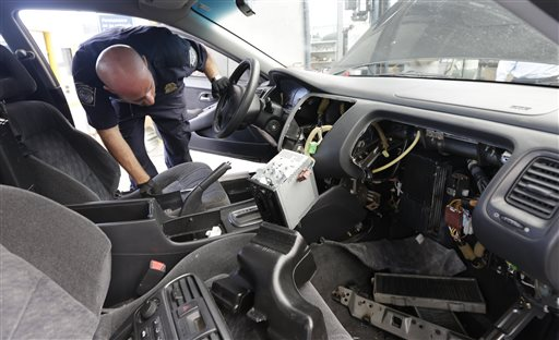 Customs and Border Protection officer Steve Delgado looks in at the dismembered dashboard of a Honda Accord after finding more than 14 pounds of methamphetamine hidden behind the radio at the San Ysidro port of entry on Thursday in San Diego.