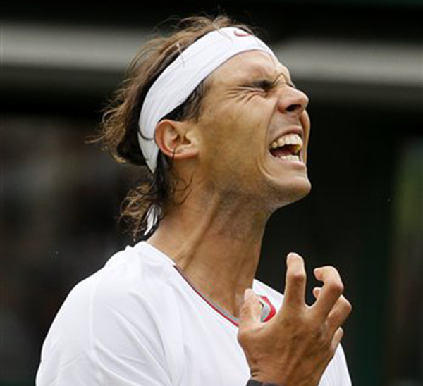 Rafael Nadal of Spain reacts as he loses a point to Steve Darcis of Belgium during their men's first round singles match at Wimbledon Monday.