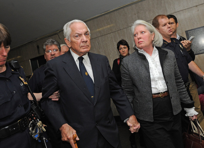 Anthony Marshall, Brooke Astor's son, center, exits court in Manhattan with wife Charlene in 2009.