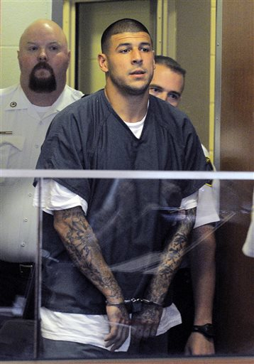 Former New England Patriots football player Aaron Hernandez enters a courtroom for a bail hearing in Fall River Superior Court on Thursday. Hernandez, charged with murdering Odin Lloyd, a 27-year-old semi-pro football player, was denied bail.