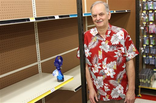 Anchorage True Value owner Tim Craig stands next to the last fan he had available for sale at the store in south Anchorage on Tuesday. He said he sold his entire stock of fans in 10 days.