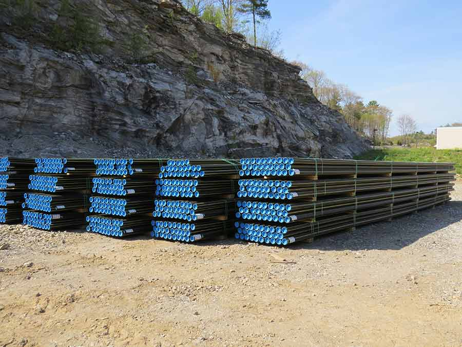 Distribution pipes are laid out at the Summit Natural Gas pipe yard in Cumberland. The pipes will be installed this summer to enable residents to connect to natural gas.