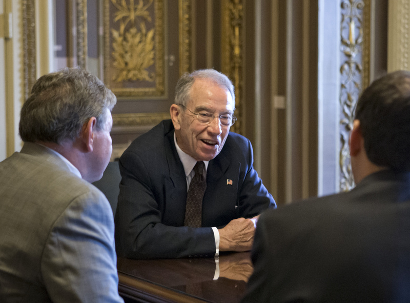 Sen. Chuck Grassley, R-Iowa, holds a meeting just off the floor of the Senate prior to a vote on a border security amendment to the immigration bill at the Capitol in Washington on Monday.