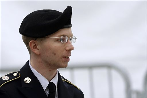 Army Pfc. Bradley Manning is escorted into a courthouse in Fort Meade, Md., before a pretrial military hearing in this May 21, 2013, photo.