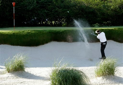 Phil Mickelson hits out of a bunker during the second round of the U.S. Open golf tournament at Merion Golf Club on Friday.