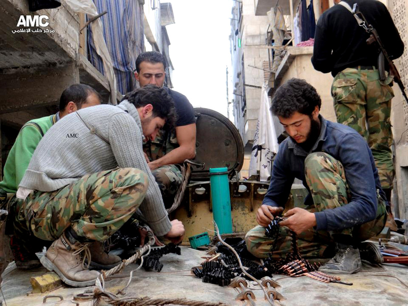A citizen journalism image that has been authenticated based on its contents and other AP reporting, shows members of the Free Syria Army preparing their weapons in the neighborhood of al-Amerieh in Aleppo, Syria, in April. Rebels say they need heavy weapons to fight government troops and to gain leverage at any bargaining table.