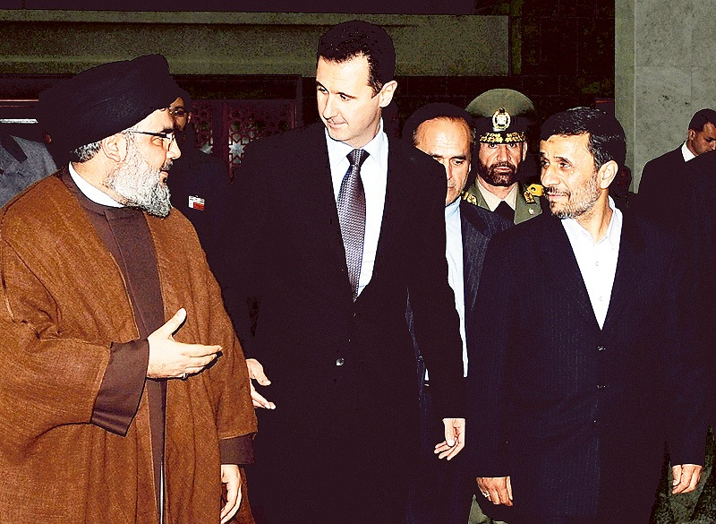 "Hezbollah leader Sheik Hassan Nasrallah, left, speaks with Syrian President Bashar Assad, center, and then-Iranian President Mahmoud Ahmadinejad in Damascus, Syria. Many are saying America should intervene in Syria, but former Sen. Barney Frank disagrees. ""I have not heard or read ... a coherent explanation of what it is they believe America can do to make it better (in Syria),"" he writes."