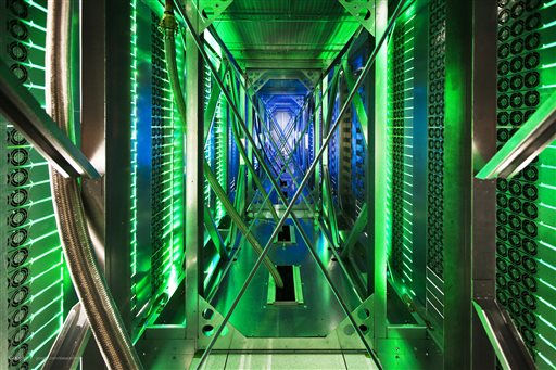 In this undated photo made available by Google, hundreds of fans funnel hot air from the computer servers into a cooling unit to be recirculated at a Google data center in Mayes County. Okla. The green lights are the server status LEDs on the from of the servers.
