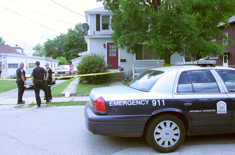 Nashua police stand outside a Newbury Street home Monday in Nashua, N.H., where a married couple were found dead.