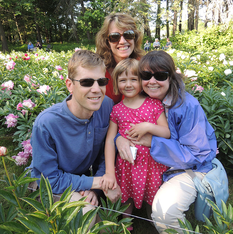 John Knight, 5-year-old Chloe Knight, Kathleen Parr and Marie Corkery enjoy the formal peony garden at Gilsland Farm.