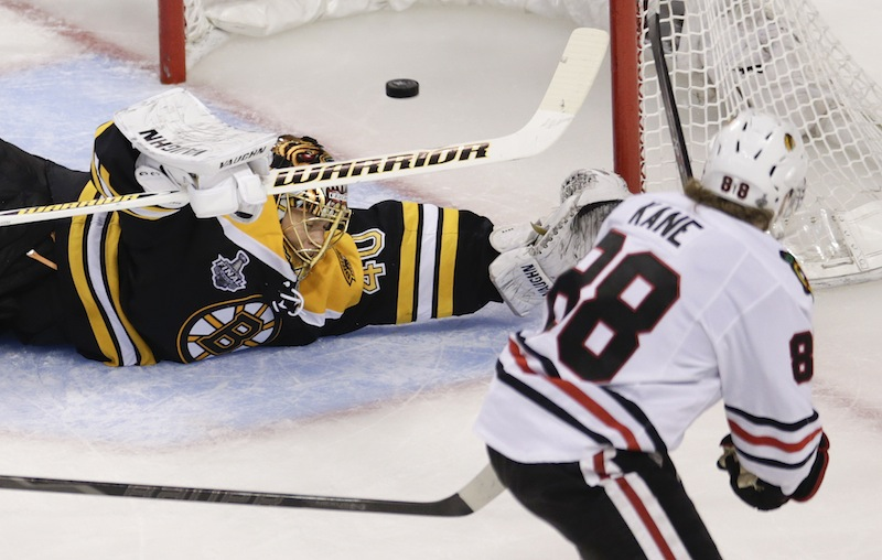 Chicago Blackhawks right wing Patrick Kane (88) scores past Boston Bruins goalie Tuukka Rask (40), of Finland, during the second period in Game 4 of the NHL hockey Stanley Cup Finals, Wednesday, June 19, 2013, in Boston. (AP Photo/Charles Krupa) TD Garden