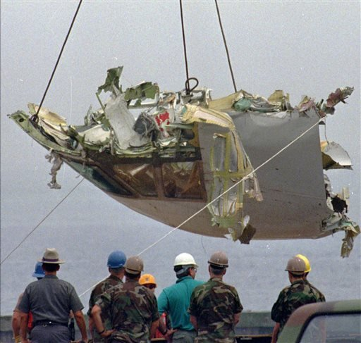 In this Aug. 7, 1996, photo, the cockpit of TWA Flight 800 is lowered at the U.S. Coast Guard station at Shinnecock Inlet in Hampton Bays, N.Y.