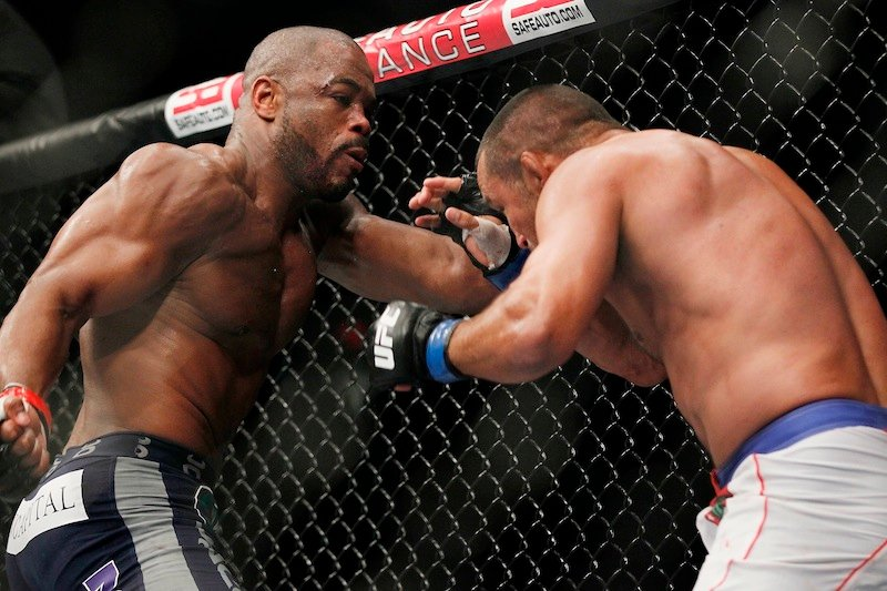 Rashad Evans backs Dan Henderson into a corner during UFC 161 in Winnipeg, Manitoba on Saturday June 15, 2013. Ultimate Fighting Championship is exploring the possibility of bringing a mixed martial arts show to the new 8,000-seat venue in Bangor, Maine, its president said Thursday, June 27, 2013. (AP Photo/The Canadian Press, John Woods) MMA;UFC;161;Winnipeg