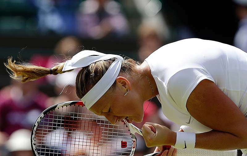 Petra Kvitova celebrates after beating Ekaterina Makarova Saturday at Wimbledon.
