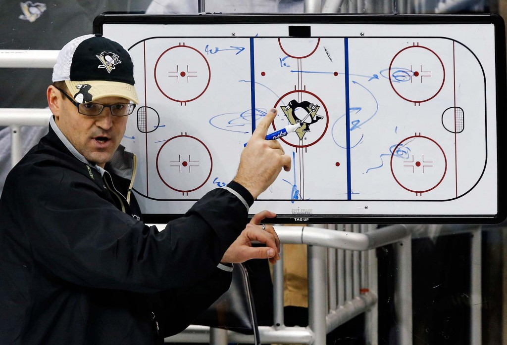 In this Jan. 14, 2013, file photo, Pittsburgh Penguins Coach Dan Bylsma outlines a drill during practice. USA Hockey hired Bylsma on Saturday as the coach for the U.S. Olympic men's hockey team at the 2014 games in Sochi, Russia.