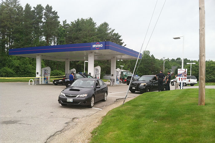 Falmouth police gather evidence at the scene of an armed robbery Friday morning at the Irving gas station at Route 1 and Bucknam Road.