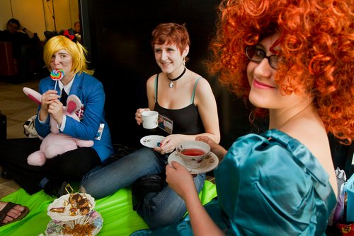 Coryn Armstrong of Cumberland, Sam Dow of Portland and Yuki Hall of Portland have a tea party during the final day of the PortConMaine festival at the Doubletree Hotel in South Portland on Sunday.